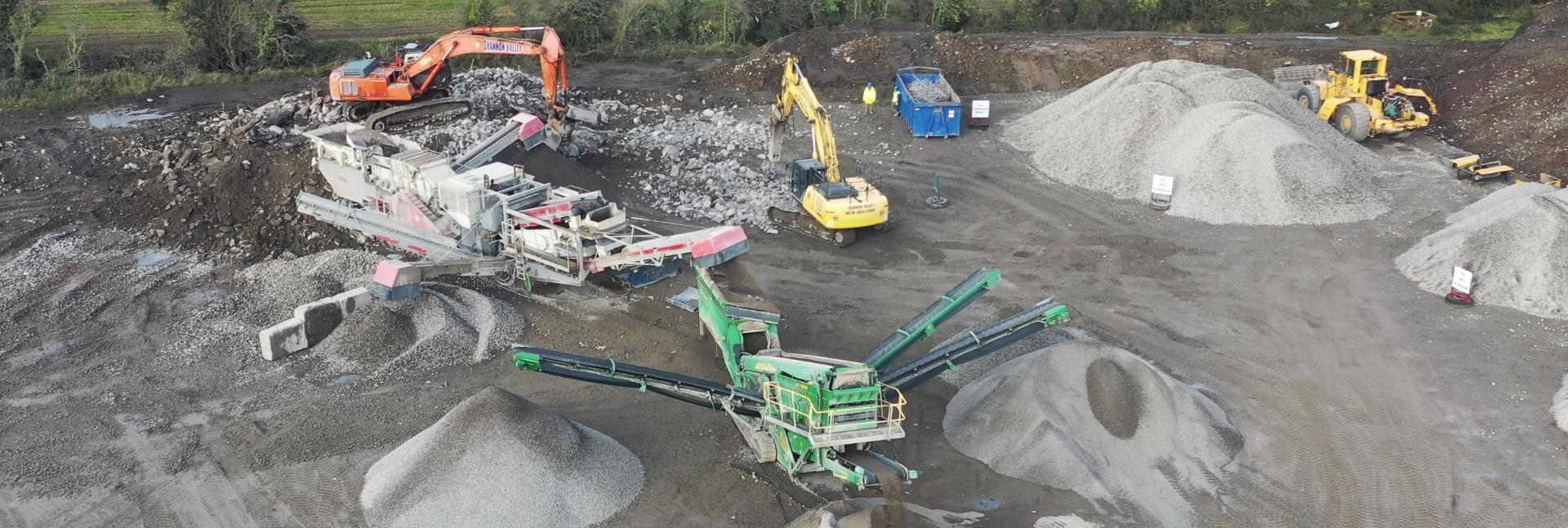 aerial shot of multiple machines working in a gravel pit